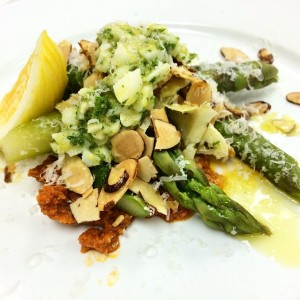 asparagus on roesco sauce with marinated artichokes topped with grated pecorino cheese